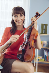 Portrait of a woman with violin in children's room