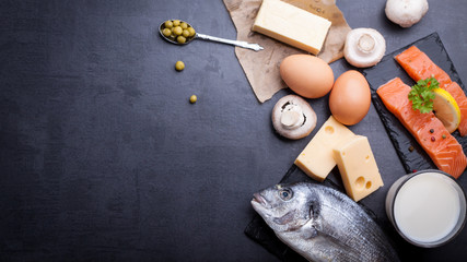 Black table with ingredients of food rich in vitamin D and omega 3, with copy space.