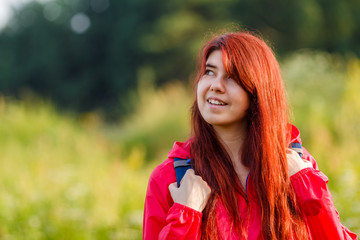 Photo of smiling girl and with backpack