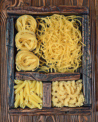 Traditional types and shapes of Italian pasta in vintage wooden box