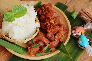 Fried pork with garlic and sticky rice