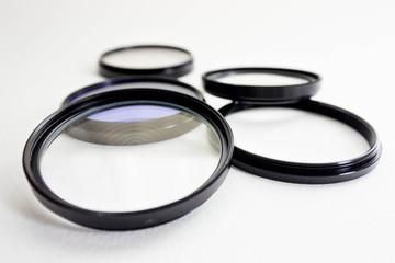 Filter for film camera on white background.