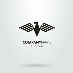 Black and white vector geometric logo of an abstract eagle