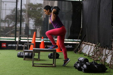 A woman works out during a training session at the RB Fitness centre in Lima