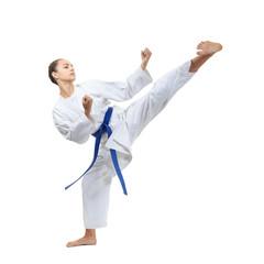 With a blue belt, an adult girl beats a kick