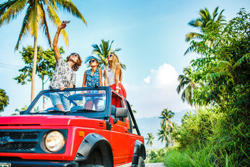 group of three russian tourists taking selfie on off road truck in koh samui thailand
