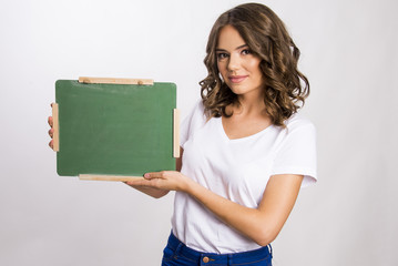 Girl holding a little green board