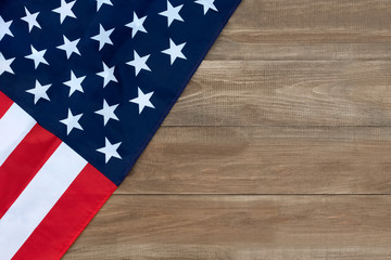 the American flag on a wooden board