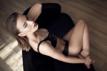 Female in lingerie lying on sofa