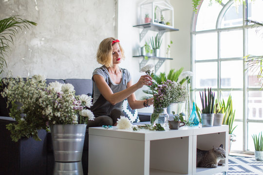 Woman making spring floral decorations