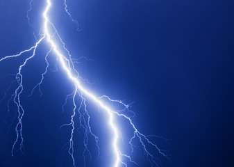 Lightning thunder bolt at blue background.