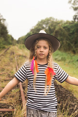 girl playing on old train tracks