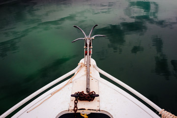 Bow of a small boat with anchor