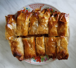 Homemade apple strudel on a tray