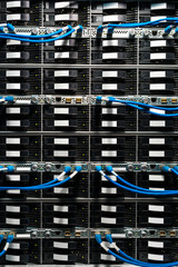 Complex array of wires at back of server cabinet