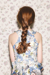 Back view of red-headed woman with braid