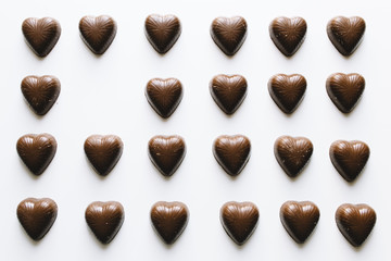 Grid of chocolate hearts with one missing