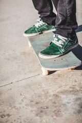 Worn Sneakers Shoes on Skateboard