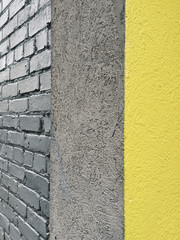 Detail of building corner with yellow stripe