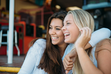 Two female friends smiling and having fun