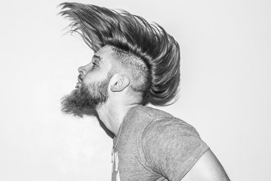 hair in motion,handsome young man with a beard and piercing