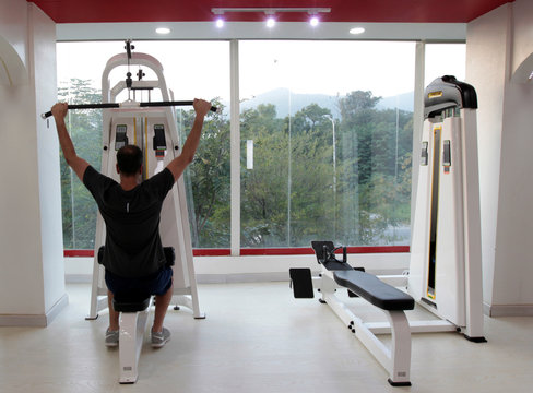 A man works out during a cross fit training at a gym in Islamabad