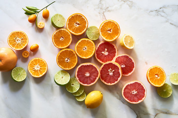 Cut citrus fruits for health and wellness on table