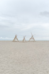 Bamboo Wigwams On A Sandy Beach