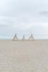 Bamboo Wigwams On A Sandy Beach