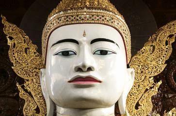 Buddha in gold, royal clothes,Ngar Htat Gyee pagoda,Yangon, Myanmar(Burma)