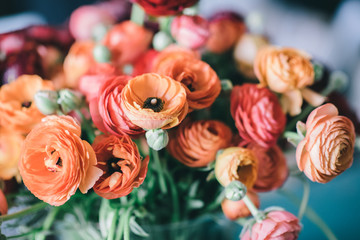 Spring flowers bouquet with orange and red ranunculus