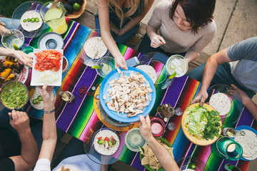 Cinco: Overhead View Of Friends Passing Food At Party