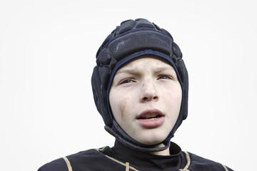 Teenage boy wearing head guard for sport
