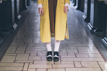 Close Up of a Stlyish Woman Wearing Vintage Yellow Coat