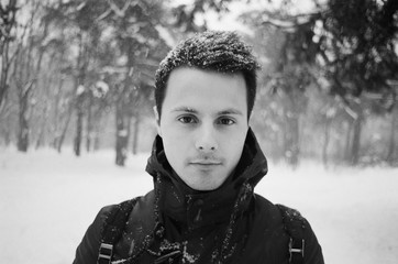 A black and white film portrait of young men with snow on his hair