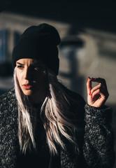 Hip young blond woman smoking