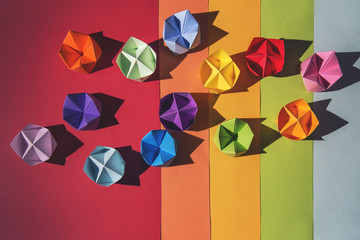 Rainbow fortune tellers on multi-coloured background...
