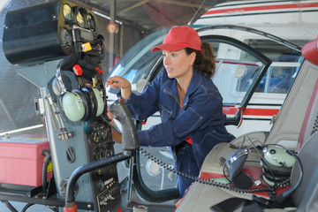 female helicopter mechanic at work