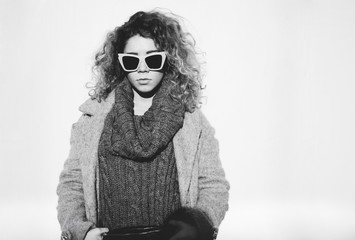 Portrait of Beautiful Young Woman With Curly Hair And Sunglasses