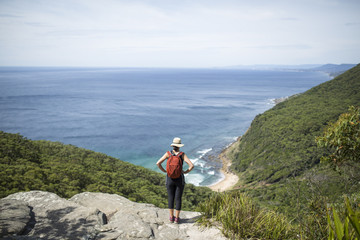 Female Hiker overlooking the ocean