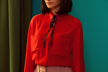 upper part of a model wearing a red shirt with foulard