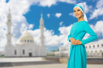 Muslim woman with white mosque