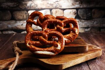 Pretzels on wooden board on rustic background. german food.