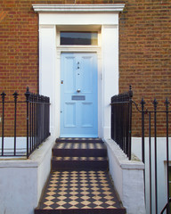 Notting hill, London, colorful entrance light blue door
