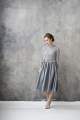 Woman wearing grey dress