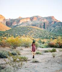 Young woman walking in desert