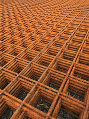 View on endless stack of rusty metal gratings
