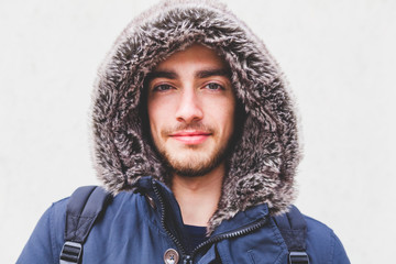 Young Man with Furred Hood during the Cold Season