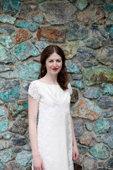 Beautiful bride in front of stone wall