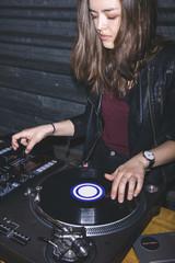 Young woman at DJ desk